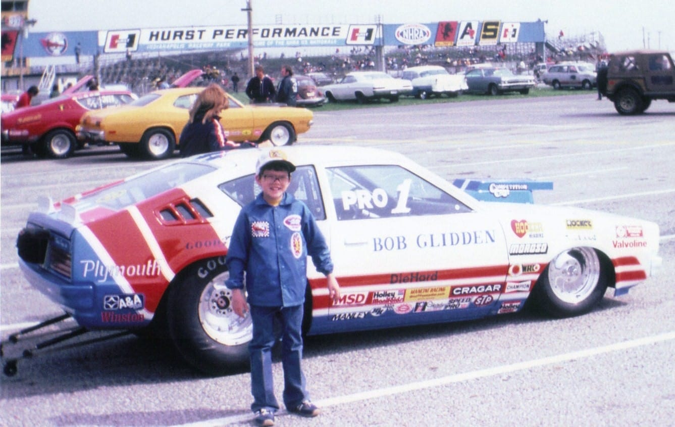 Marc Erickson in front of a stock car