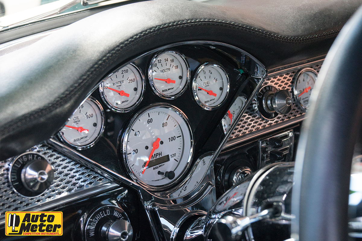 Autometer dials nested into the dash of a car