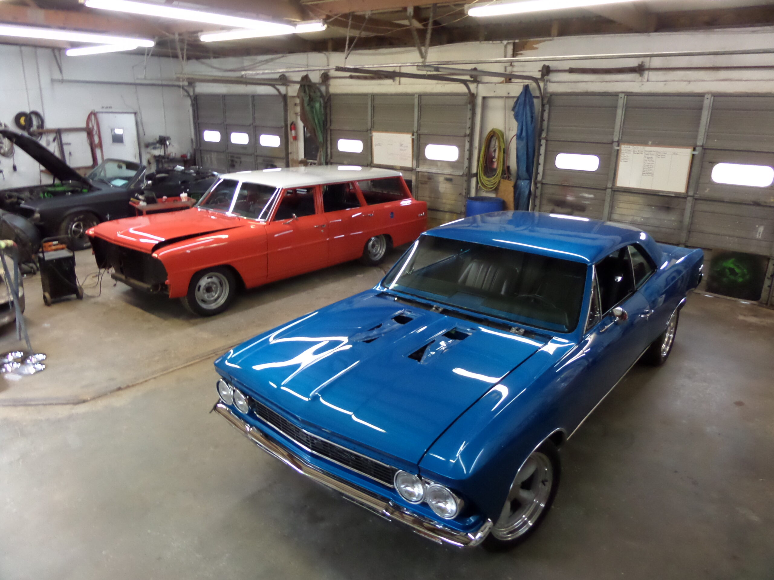 1966 CHEVELLE SS next to another custom